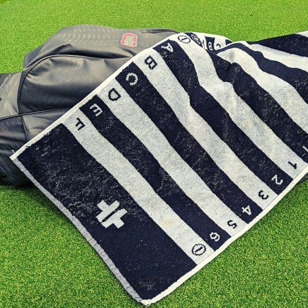 black golf swing alignment towel